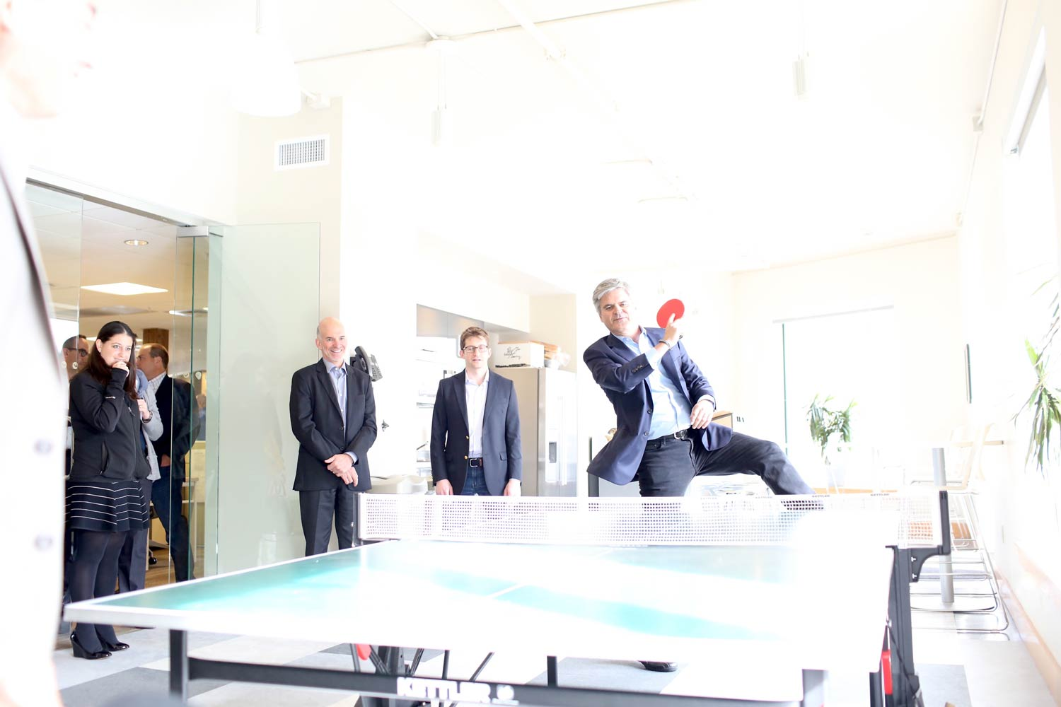 Steve Case plays ping pong with Bob Neveu on Rise of the Rest Tour
